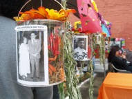 Photos of the deceased line an altar.