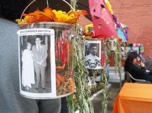 Photos of the deceased line an altar.