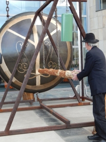 William T. Wiley ceremoniously banging the gong.