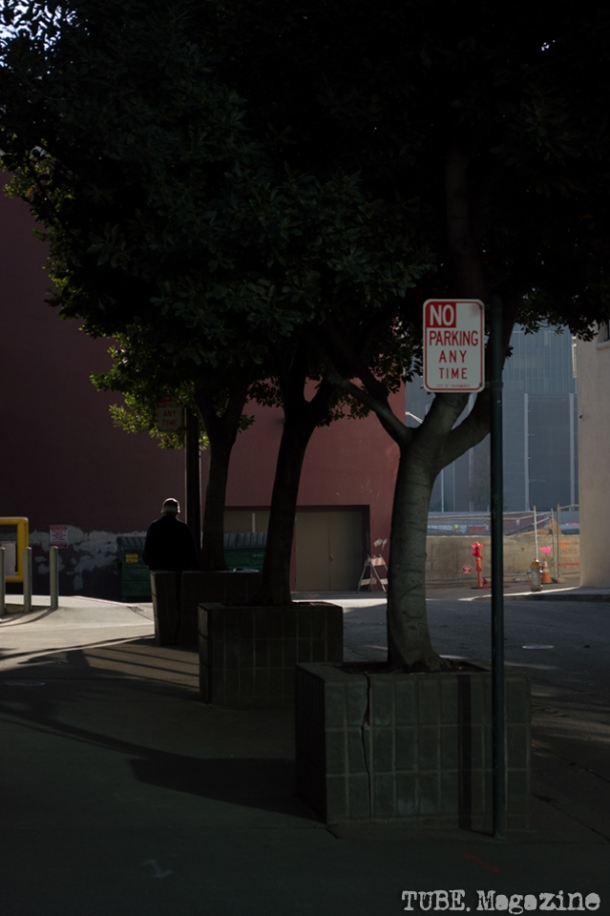 A man takes a smoke break in an alley with access to the former Downtown Plaza, site of the future Sacramento Kings Stadium. Photo M.Hershenow. 2014.