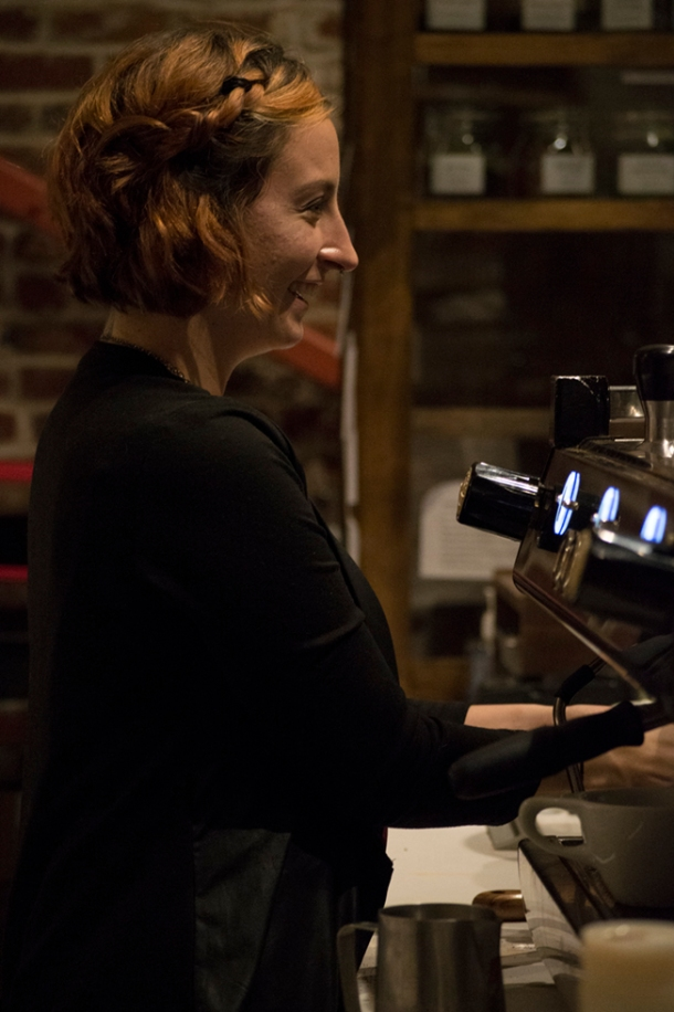 Macaela preps her espresso while talking with a customer. Photo M.Hershenow. 2014.