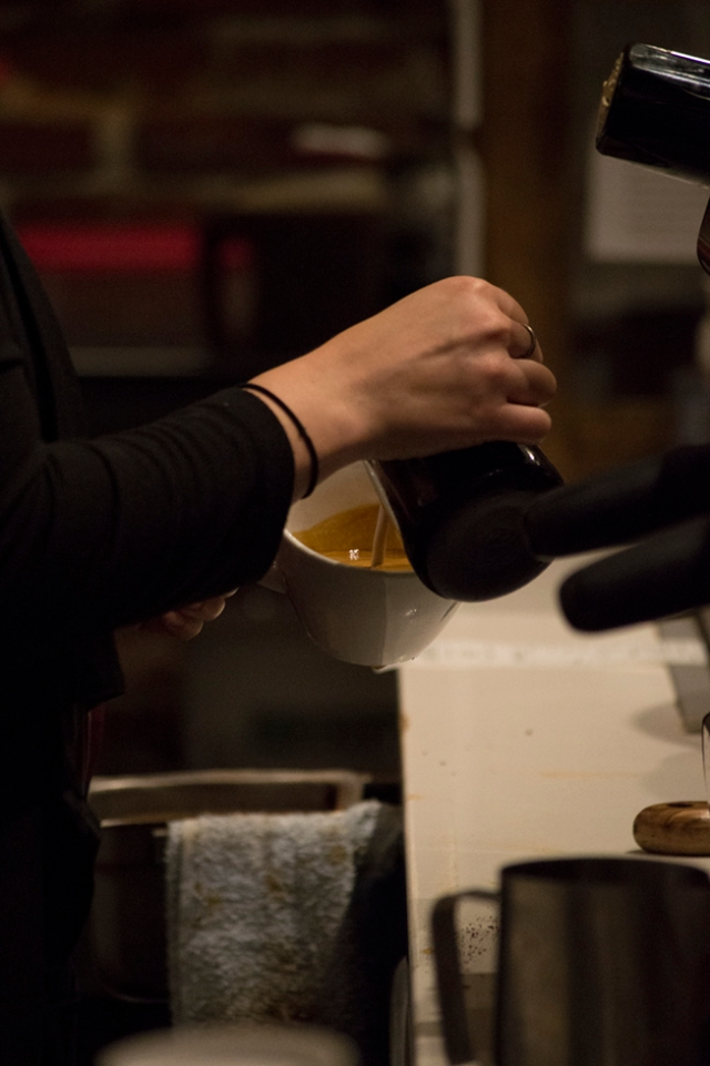 The pour. It is during this step that a skilled barista creates a the latte art which has become iconic to specialty coffee. Photo M.Hershenow. 2014.
