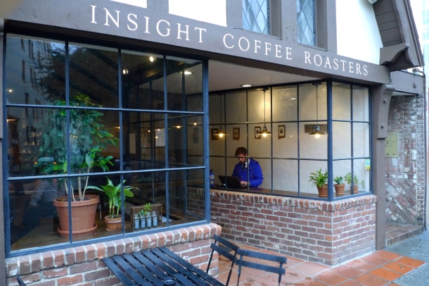 "Passersby get a quick peak at Logan Fessler's ""No Past, No Future"" exhibit at Insight Coffee Roasters in downtown Sacramento"