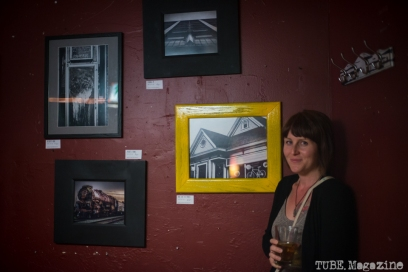 "Artist Sarah Elliott amongst her photographs hanging at ""The Wall"" at The Hideaway located in Sacramento CA. May 2015. Photo Melissa Uroff"