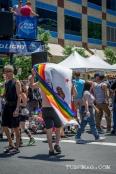 Man walks through the crowds with his California Rainbow flag at Sac Pride 2015, Photo Sarah Elliott