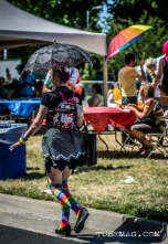 Festival goer running to get out of the heat at Sac Pride 2015, Photo Sarah Elliott