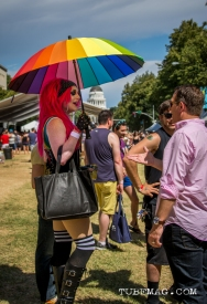 Woman hiding under her umbrella from the sweltering heat of the sun at Sac Pride 2015. Sacramento, CA. 2015, Photo Sarah Elliott