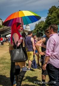Woman hiding under her umbrella from the sweltering heat of the sun at Sac Pride 2015. Sacramento, CA. 2015, Photo Sarah Elliott