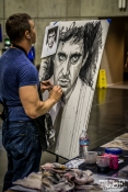 Artist Rob Prior live painting in front of his art booth at Sacramento Wizard World Comic Con 2015. Photo Sarah Elliott