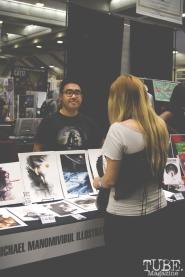 Jen Wohlf buys art from illustrator Micheal Manomivibul. Sacramento Wizard World Comic Con 2015. Photo Sarah Elliott