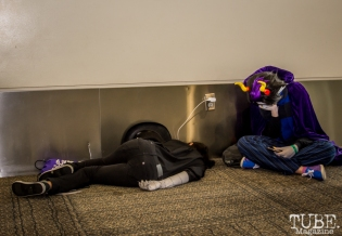 Extremely worn out people taking a nap in the hall. Sacramento Wizard World Comic Con 2015. Photo Sarah Elliott