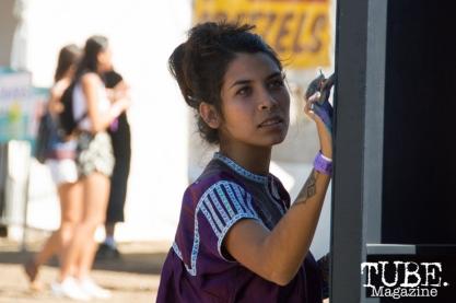 Carmín Gortez (@carmingortez) painting a mural at TBD Festival in Sacramento, Ca. September 2015. Photo Alejandro Montaño
