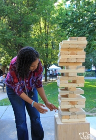 Carley Herron, audience member playing Jenga, Concerts in the Park, Cesar Chavez Park, Sacramento, CA. May 13, 2016, Photo Anouk Nexus