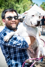 Serious Talk. Seriously. Podcast host Johnny Flores, along with dog Fran, at the Crocker Block by Block Party in District 5, July 9, Sacramento CA. Photo Melissa Uroff