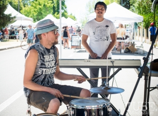Artists Shaun Burner (left) and Waylon Horner trying out instruments at the Crocker Block by Block Party in District 5, July 9, Sacramento CA. Photo Melissa Uroff