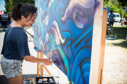 Francesca Gomez painting at the Crocker Block by Block Party in District 5, July 9, Sacramento CA. Photo Melissa Uroff