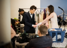Daniel Laukat of Daniel Laukat Couture behind the scenes getting models ready for the fashion show at Vintage Swank ArtMix, Crocker Art Museum, March 2017. Photo Melissa Uroff