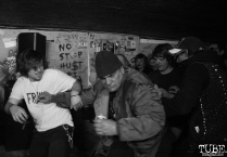Audience members moshing for Red Pills at Casa de Chaos, in Sacramento Ca. December 15th 2017. Photo Anouk Nexus
