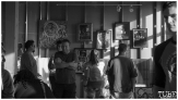 A crowd gathers for the pop up gallery during First Friday Oak Park in Sacramento CA. May 4th, 2018. Photo Benz Doctolero