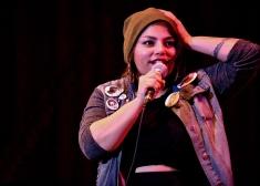 Rachel Myles speaking into a microphone
