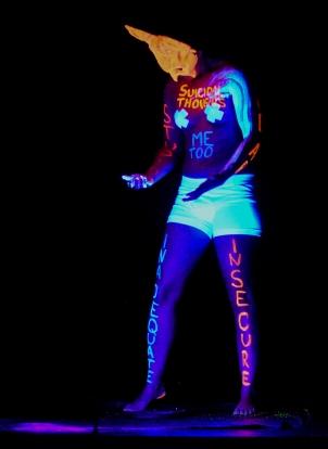 Mr. Siracha performing under black light